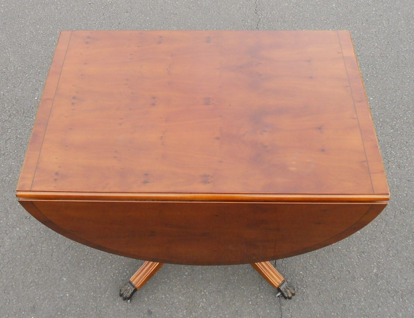 Yew Oval Dropleaf Dining Table